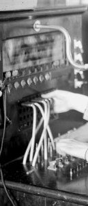 Phone operator using a switchboard