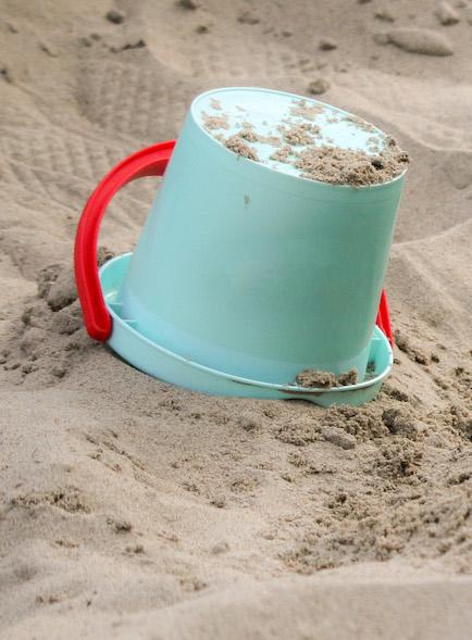 Spilled bucket of sand